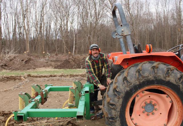 Matt tracy on tractor at Urban Edge Farm